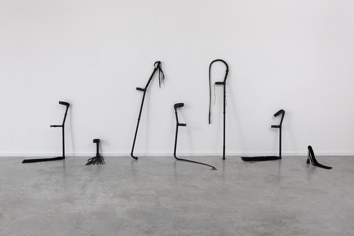 Untitled, 2018, crutches, whips, leather, glue 401x137x83 cm