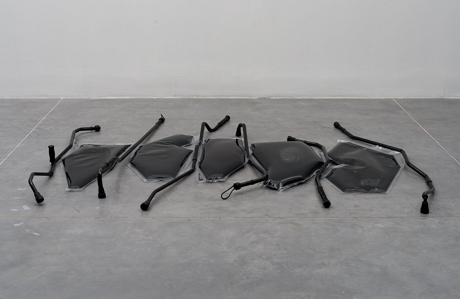 Untitled, 2018 (from the project: Unreasonable Doubt), crutches, whips, metals, PVC, ink, water, 246x200x13 cm