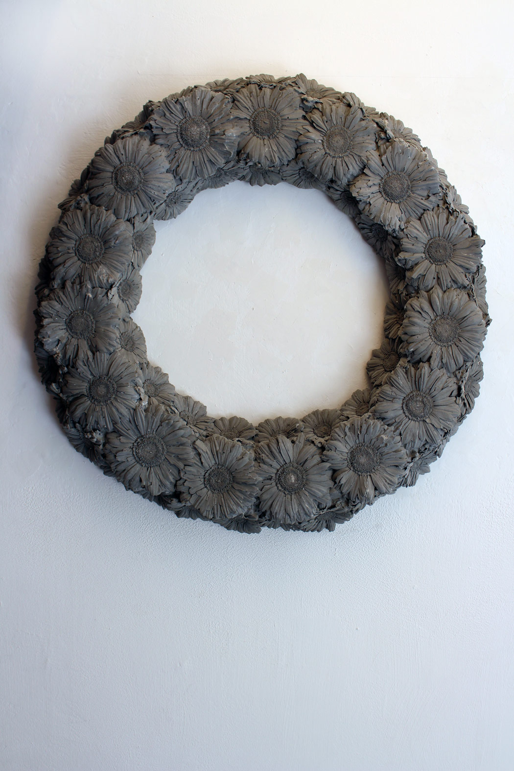 Erez Israeli, Untitled (Garland), 2002, concrete cast, 60 cm diameter