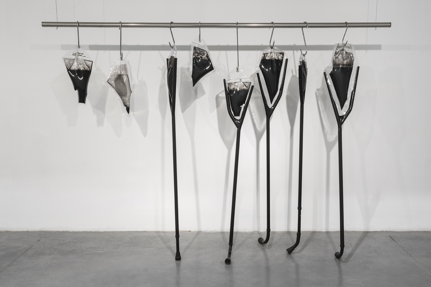Untitled (from the project: Unreasonable Doubt), 2018, crutches, whips, metals, PVC, ink, water, 250x172x50 cm