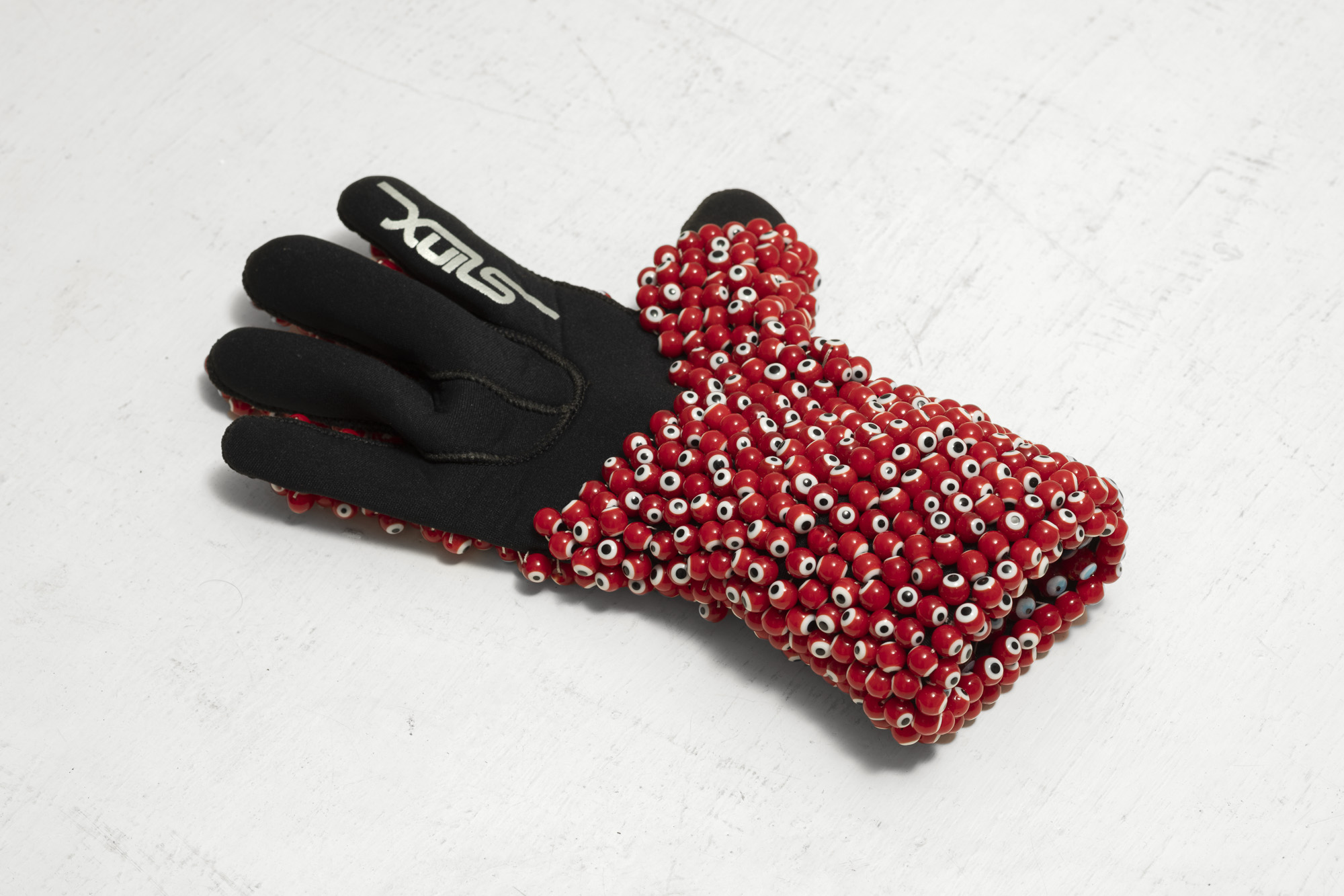 Left Hand, 2016-17, glove, evil eye beads, thread